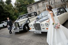 Bride and groom with Regent and Daimler
