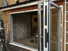 White Bifold 3 part Aluminium outward stacking