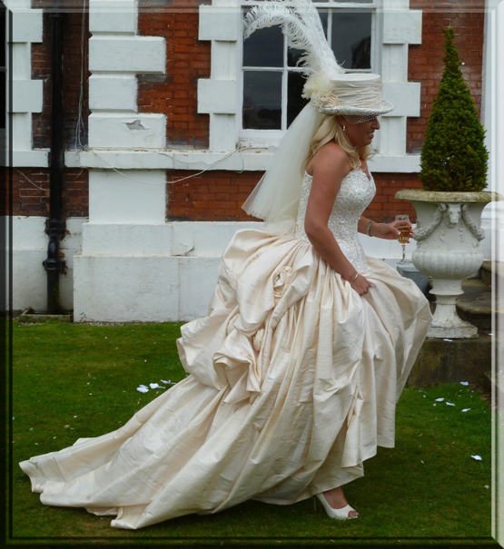 Vintage Victorian style ivory silk wedding dress with feather top hat