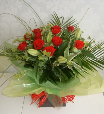 G49 Red roses and lilies hand-tied aqua