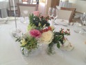 Eclectic vintage vases wedding centrepieces