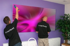 Video footage of an installation of Theartbay's corporate art