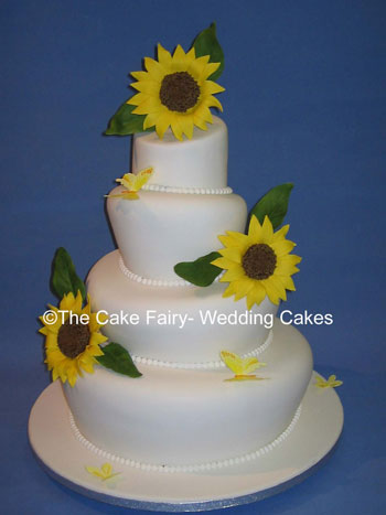 RW2   WONKY GARDEN   4 Tier wonky garden cake with handcrafted sugar sunflowers and butterflies