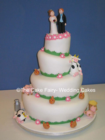 RW6  WONKY FARMER & WIFE     4 tier wonky farmyard and sugar animals. Bride and Groom dressed in wedding attire