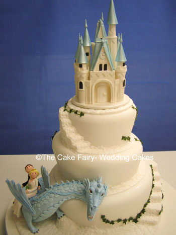 RW7 WONKY FAIRYTALE CASTLE & DRAGON  3 tier wonky fairytale cake.Sugar fairytale castle. Sugar dragon with sugar Bride and Groom in wedding attire.Cobbled effect steps and ledgesFondant ivy trails.