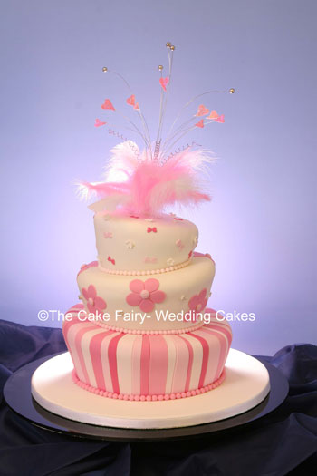 RW8  HIPPY WONKY   3 tier wonky cake with hippy style flowers.Topper of wired feathers