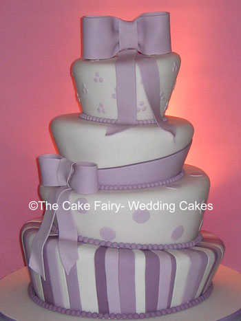 RW1 WONKY BOWS   Wonky wedding cake with sugar bow and sash decoration