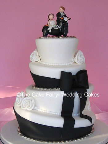 RW10 WONKY STUDS & ROSES   Wonky black and white wedding cake decorated with sugar bow and stylised roses. Sugar motorbike and sidecar topper