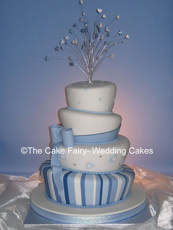 RW12 WONKY STRIPES & BOW   Wonky wedding cake decorated with a sugar bow and sash with a hidden dog.Topper of sugar wired hearts