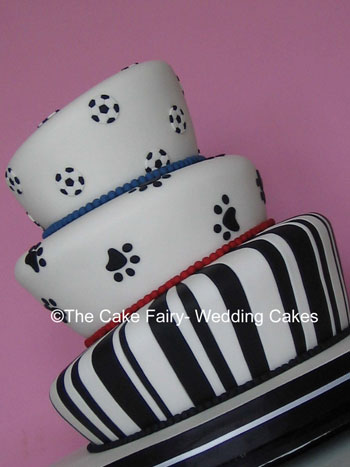 RW16  WONKY PAWS   A really different wonky wedding cake. Decoration of sugar paw prints and footballs.