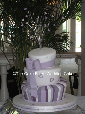 RW20   WONKY HEARTS   Stylish purple wonky cake with wired heart topper