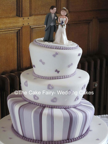 RW21 WONKY SWEETHEARTS    Cute wonky wedding cake in a manor house setting with sugar bride and groom topper