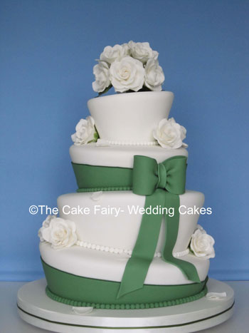 RW22  WONKY ELEGANCE   Elegant wonky wedding cake with akito style sugar roses and  large sugar bows