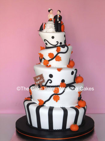 RW25  WONKY PUMPKIN   Very striking wonky wedding cake on a halloween theme with a sugar Bride and groom topper