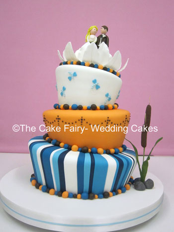 RW37 WONKY WATERSIDE  A fun and colourful wonky with handcrafted bullrushes, bride and groom and delicate waterlily
