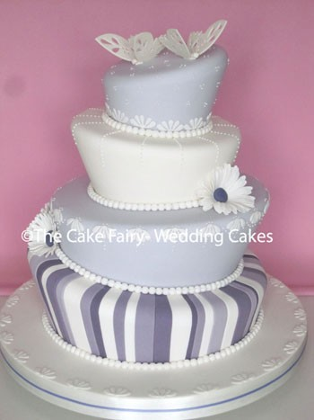 RW38 WONKY BUTTERFLIES  Lots of sugarwork and flowers finish off this pretty lilac tone Wedding Cake