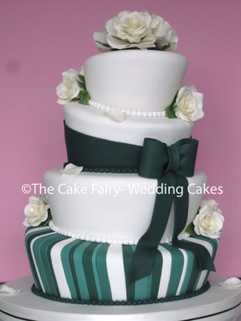RW43 WONKY EMERALD   Shades of green icing and handcrafted sugar roses  give this wonky Wedding Cake a very elegant look