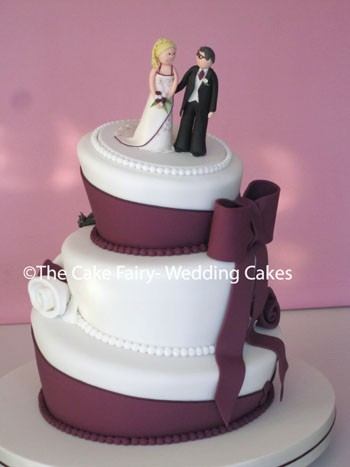 RW48 WONKY AUBERGINE  Decorated with a sugar bow and tails following the colours of the Brides gown