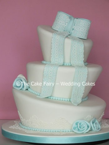 RW60 WONKY LACY BOW  A vintage inspired Wedding cake with edible lace applied to the sugar work