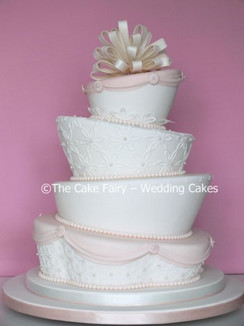 RW61 WONKY BLUSH  An intricate elegant duo shaped cake with a lacy look