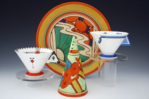Three Clarice Cliff conical sugar sifters in the Bobbins, Coral Firs and Aurea patterns