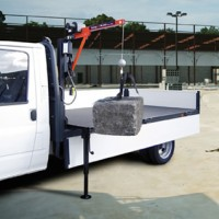 A lightweight, de-mountable, 250kg capacity electric crane for pick-ups, drop sides, flat beds and vans.