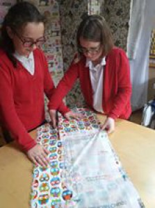 A couple of Stitch kidz cutting out a top