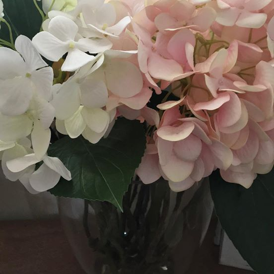 Faux flowers - pink and white hydrangeas in glass vase