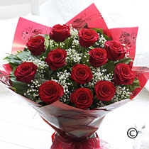 Twelve Red Roses Bouquet  with free chocolates
