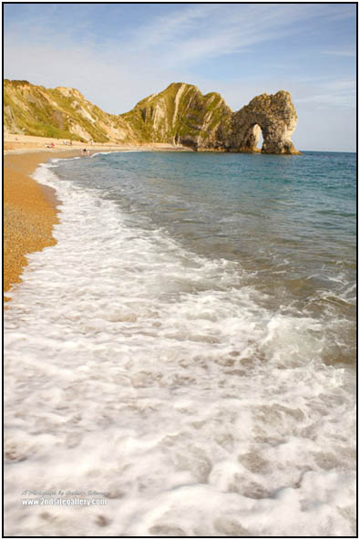 Durdle door and the sea an original photograph in portrait format by Graham Coleman