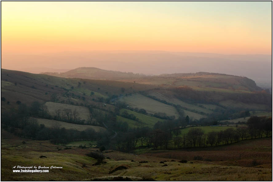 Evening glow on the foothills of the Black mountains of South Wales, viewed from the flanks of Hay bluff