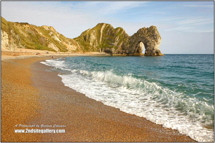 Breaking Wave and Durdle door a photograph by Graham Coleman