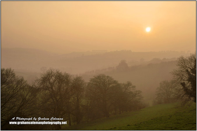 Misty sunset on the Lansdown hills