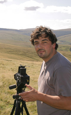 Picture of landscape photographer with camera on tripod