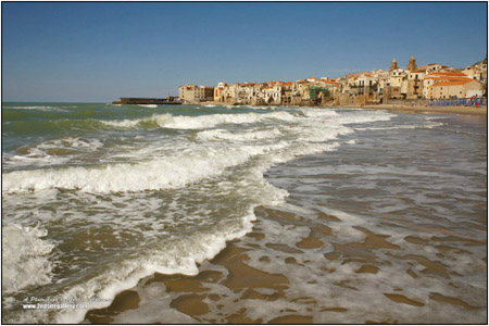 view of waves breaking at Cefalu in bright sunshine