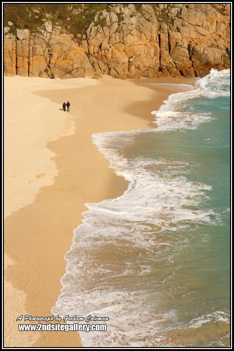 Couple walking on the beach, arial view of Porthcurno, Vioews of Cornish beaches