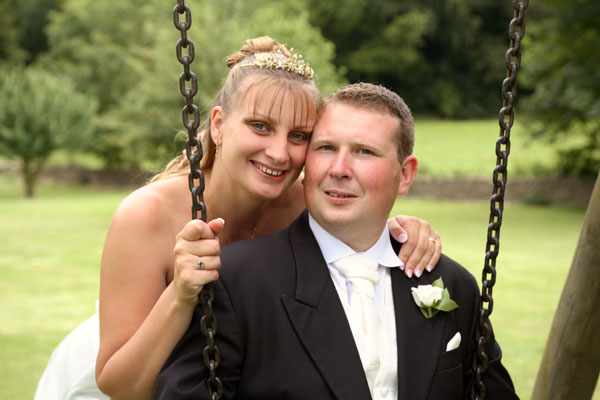 The Bride and Groom on a swing- calssic wedding pictures by Graham Coleman
