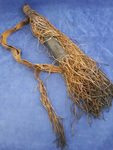 An African Or Indian Leather Tooled Arrow Quiver Containing Nine Steel Tipped And Barbed Arrows
