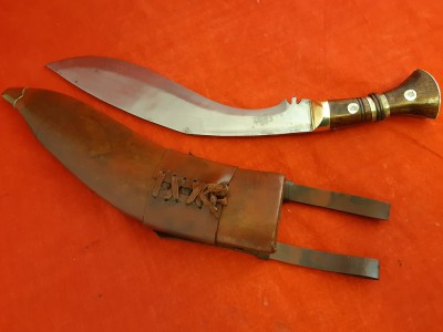 Reproduction Of A 1917 Dated British Army Officers Kukri In Brown Leather Covered Scabbard