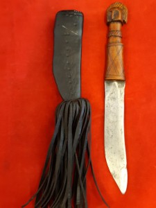 An African Tribal Dagger In Leather Scabbard