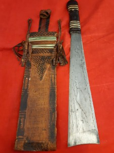 An African Tribal Triangular Bladed Machette In Leather Scabbard