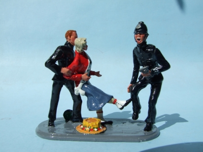 POLICEMAN BEING KICKED ON THE SHIN BY SUFRAGETTE