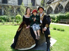 Young Prince trying on clothes with Farthingale''s Tudor court at Gloucester.