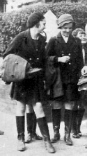 NCH children in raincoats and wellingtons