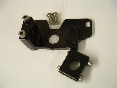 Adaptor block for fitting one piece handlebars