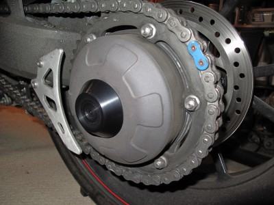1050 Speed Triple R from VIN 735337 Left Side Axle Cover