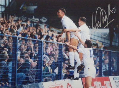 Vinnie Jones Signed Leeds United Kop Legend - Iconic Image on the railings celebrating scoring with the fans