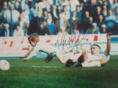 Vinnie Jones Signed Iconic Image - Tackles Club Mascot out