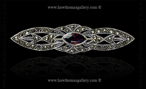 Silver Marcasite Brooch set with a Garnet Stone