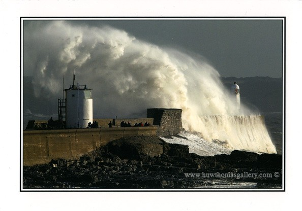 Storm wave hitting Porthcawl seawall and lighthouse - Card